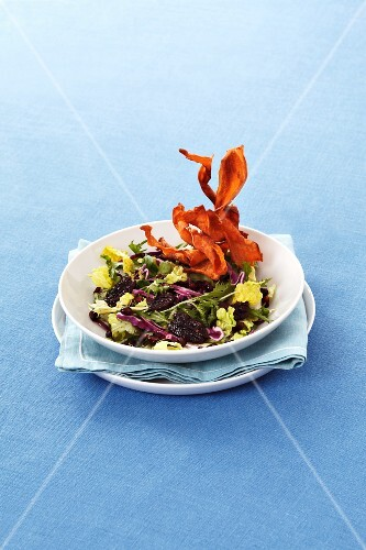 Mixed leaf salad with red cabbage, Brazil and fried sweet potatoes
