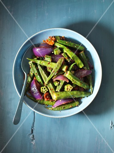 Okra pods with red onions
