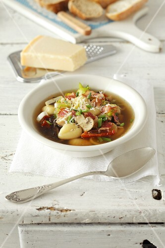Mushroom soup with gnocchi, leek, dried tomatoes, mushrooms and Parmesan