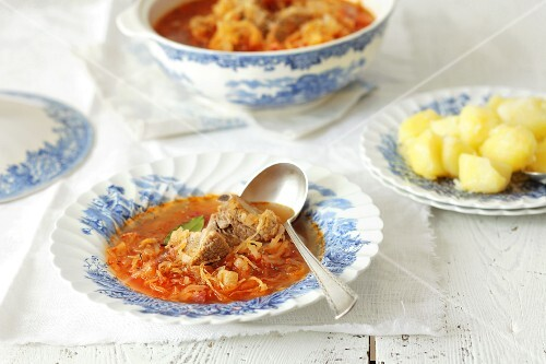 Sauerkraut soup with pork and boiled potatoes