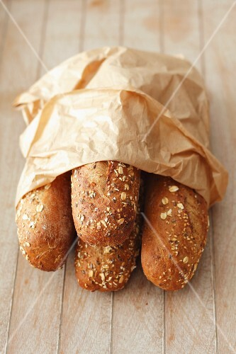 Seeded rolls in a paper bag