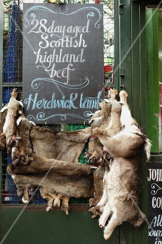 Lamb hanging on a market stall