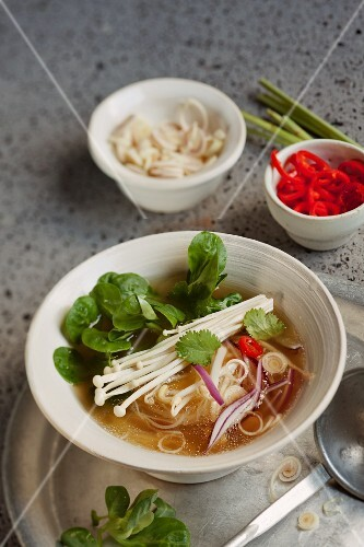 Vietnamese soup with vegetables and rice noodles