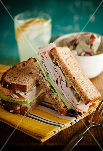 Turkey Sandwich on Wheat Bread; Halved; Potato Salad