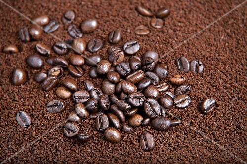 Coffee beans in coffee powder