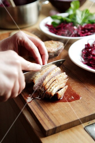 Roasted duck breast being sliced
