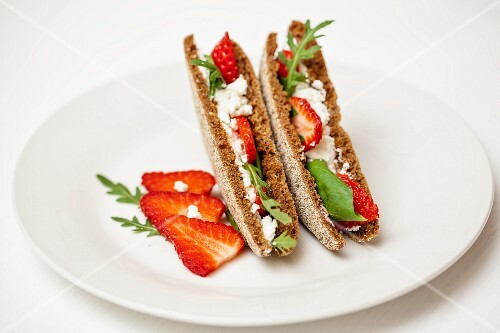 A toasted cream goat's cheese and strawberry sandwich