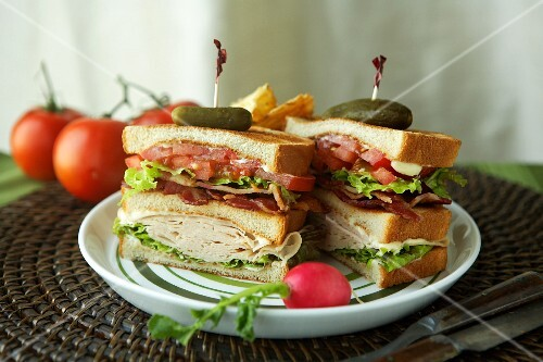 Club Sandwich Halved with Pickles and Toothpicks