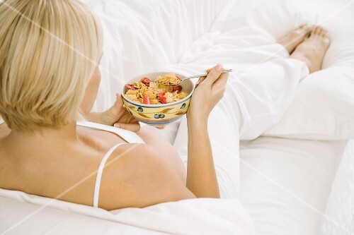 A pregnant woman eating breakfast