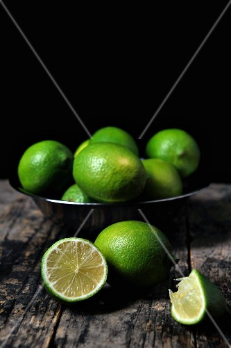 A bowl of limes, whole and halved