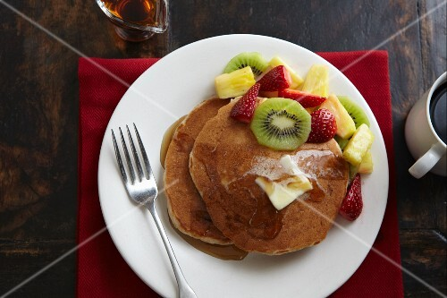Pancakes with Butter, Maple Syrup, Kiwi, Strawberries and Pineapple