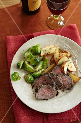 Sliced Beef Tenderloin with Roasted Potatoes and Pan Sauteed Brussels Sprouts