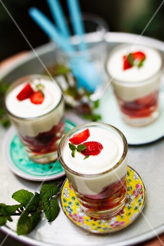 Strawberry desserts in glasses on a table outside