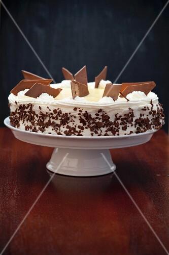 Banana and eggnog cake on a cake stand