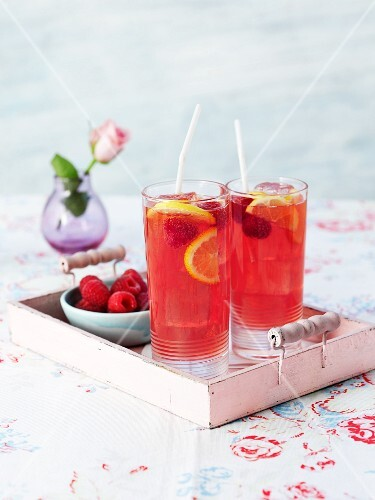 Two raspberry cocktails on a tray
