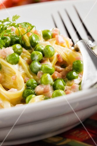 Pasta with Sliced Ham and Peas in a Garlic Butter Sauce; Close Up
