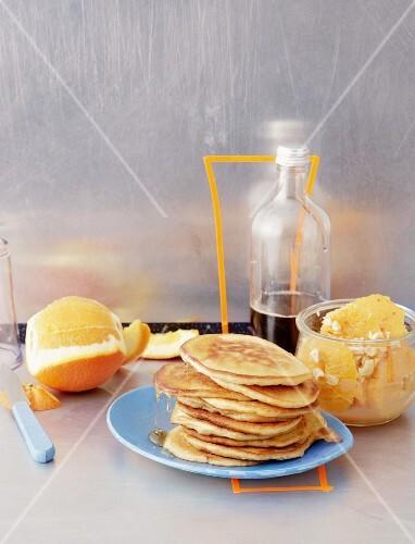 Pancakes with orange fruit salad