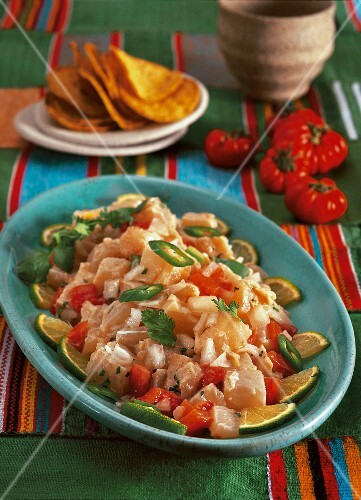 Ceviche with tomatoes and tortilla chips (Mexico)