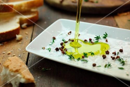 Olive oil being poured over salt