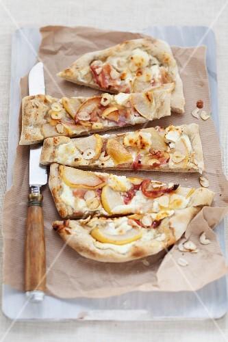 Tarte flambée with pears and hazelnuts