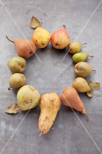 A circle made from assorted varieties of pear