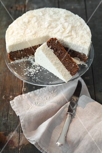 Poppy seed cake topped with coconut mousse, partly sliced