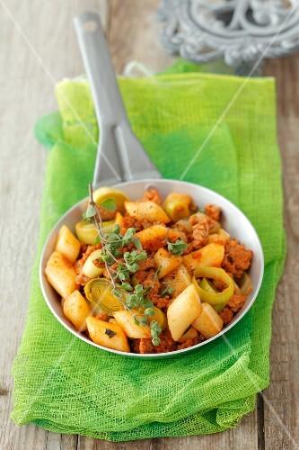 Gnocchi with pork, leek and tomato sauce