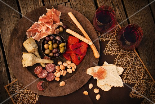 Spanish Tapas with Salami, Almonds, Peppers, Jamon Iberico, Olives, Bread Sticks, Crackers and Red Wine