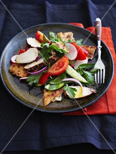 Fattoush (Arabian bread salad) with chicken breast