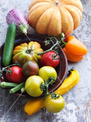 An arrangement of vegetables with tomatoes and pumpkins