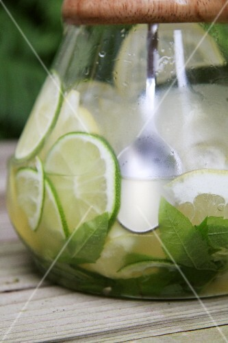 Limeade in a glass jug