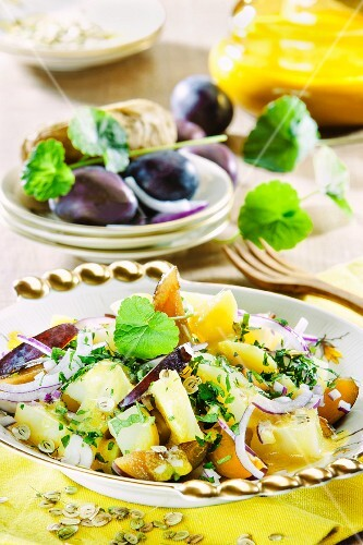 An autumnal salad with damsons and onions