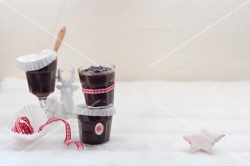 Plum sauce in jars in wintry surroundings