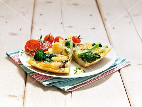 Potato tortilla with broccoli and tomatoes