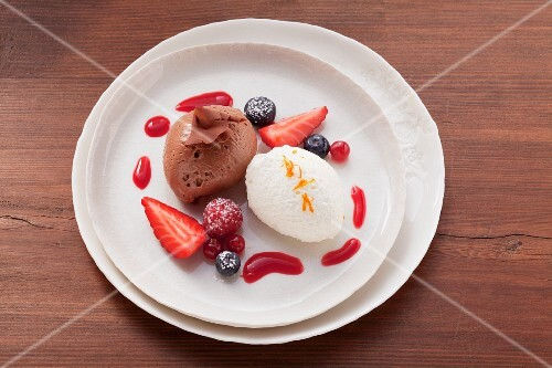 Light and dark mousse au chocolat with berry sauce
