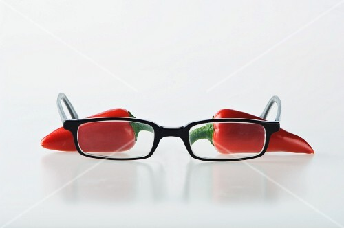 Two red chilli peppers with a pair of glasses