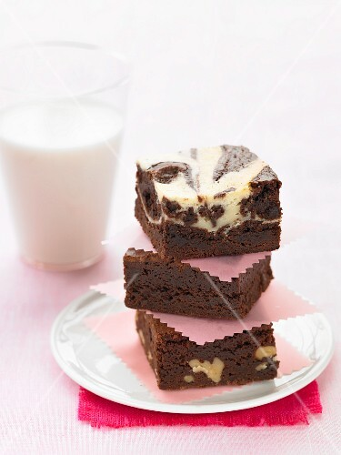 A stack of brownies and a glass of milk