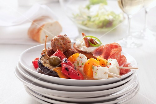 Kebabs, grilled vegetables and meatballs on a plate