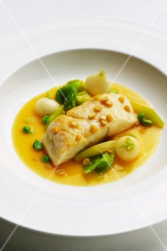 Bass in a saffron sauce with Savoy cabbage, young turnips and yellow split peas