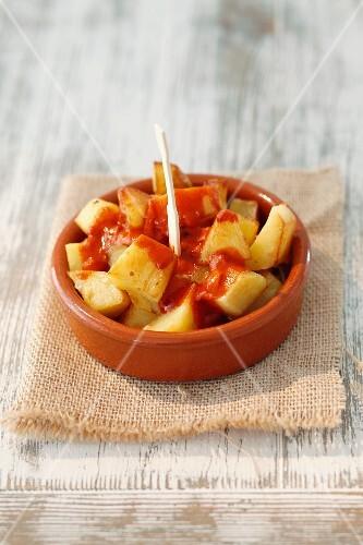 Patatas bravas (spiced potatoes with sauce, Spain)