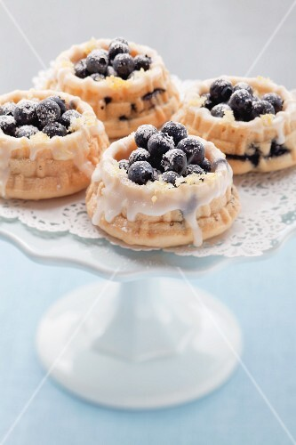 Mini blueberry tarts on a cake stand