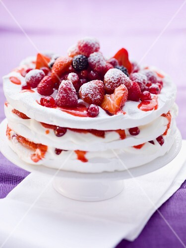 Pavlova with fresh berries on a cake stand