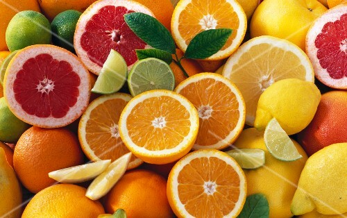 Citrus fruits, whole and halved