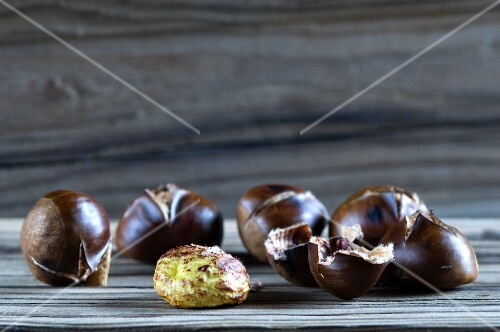 Roasted chestnuts, one opened