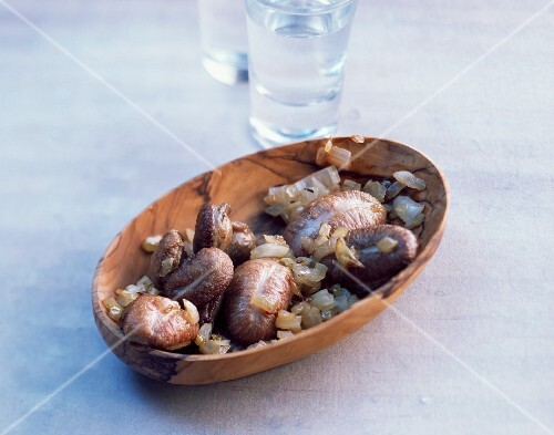Piglets testicles with onions