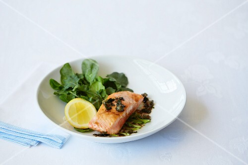 Fried salmon fillet with capers and a side salad