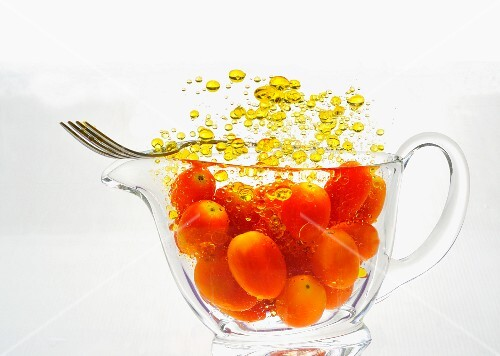Cherry tomatoes with droplets of oil
