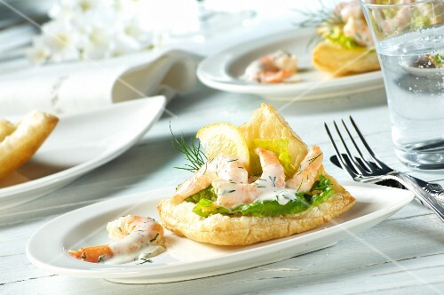 Prawns in a dill and yoghurt sauce on puff pastry with lettuce