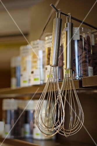Whisks hanging from a hook