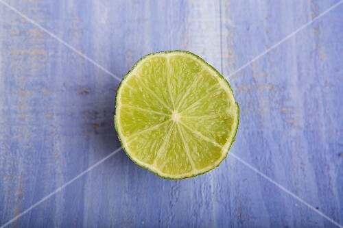 Half a lime on a blue surface